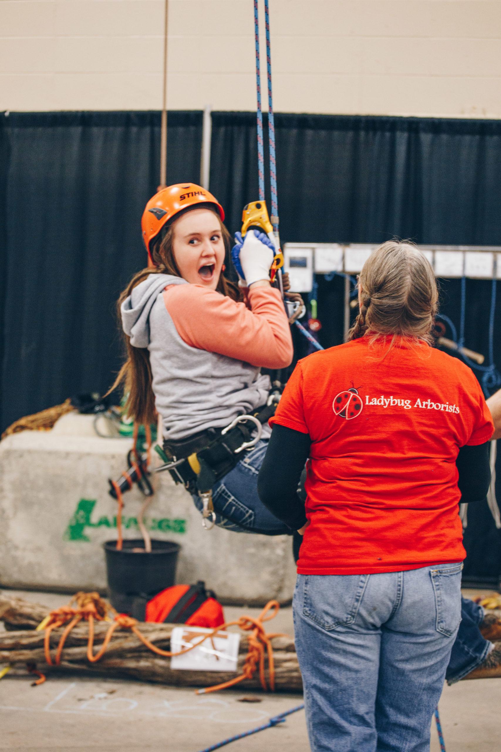girl in harness swing aborist